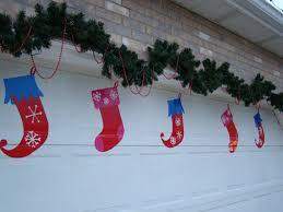 Christmas Decoration For Garage Door by Holiday Home Decorating U2013 Garage Door Decor Completes The Look