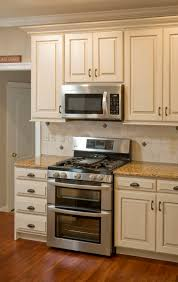 Painting Kitchen Cabinets Off White Kitchen Beige Painted Cabinets Redtinku