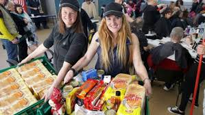 hundreds gather in invercargill for free haircuts food and