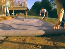 roll fabric out and secure along edges how to build a paver patio