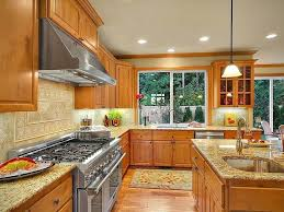 what color countertops with honey oak cabinets ornamental granite pictures cost pros and cons granite countertops