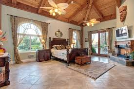 traditional master bedroom with ceiling fan doors in