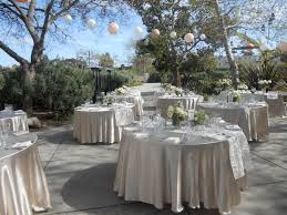 linen rentals for weddings chagne satin linen with an ivory organza satin brocade table