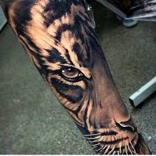 black and grey tiger head tattoo on arm sleeve