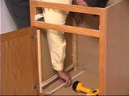 Pull Out Cabinet Shelves by Adjustable Pull Out Shelves Youtube