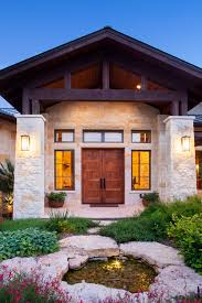 stone columns wood beam details and large windows add interest