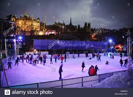 people ice skating in princes street gardens during the edinburgh