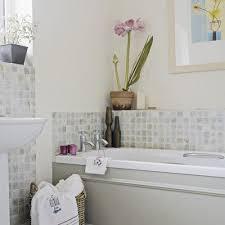 tiny splash back around bath and behind basin neutral bathroom