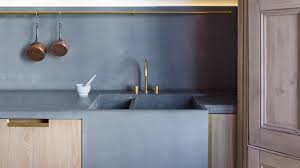 polished concrete worktops light fixtures brown wooden kitchen