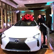 white lexus with red bow tiffany paige on twitter