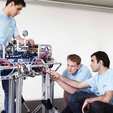 thesis in electrical engineering master s programs department of mechanical and process fotography of three students in front of technical equipment with eth logo