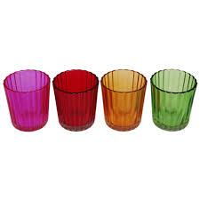 of 4 vintage coloured tea light holders