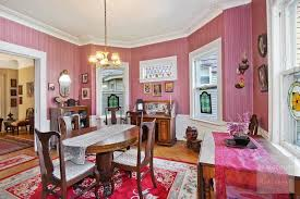 prominent architecture couple buys pretty in pink victorian in