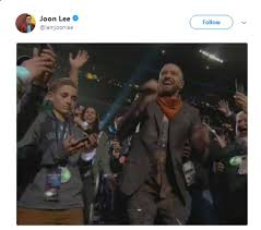 Kid On Phone Meme - the kid on his phone during the halftime show is the hero we need in