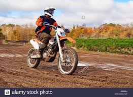 extreme motocross racing motocross enduro rider on dirt track extreme off road race hard