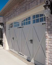 garage doors they look like old wood but theyre new and steel