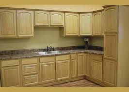 light brown wooden cabinet with l shape plus gray marble counter