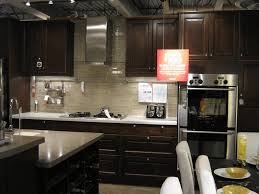 kitchen island hanging pot racks dark wood kitchen cupboards sandy white raised panel kitchen