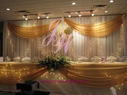 wedding backdrop gold twinkle lights and gold sash backdrop decoration backdrops