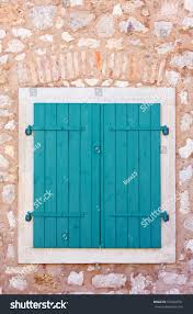 closed green wooden window shutters security stock photo 102030751
