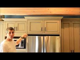 how to trim cabinet above refrigerator refrigerator surround cabinets