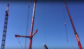 watch australian based gillespies crane erect a liebherr tower