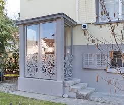 kosten balkon anbauen metall werk zürich ag windfang abschluss mit ornamenten
