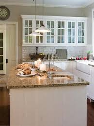 white kitchen cabinets with gold countertops in the kitchen home kitchens home home decor