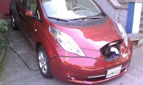 red nissan file red nissan leaf recharging jpg wikimedia commons
