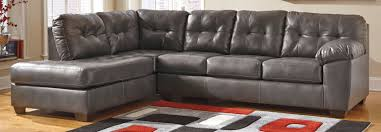 living room millennium ashley furniture signature by gray couch