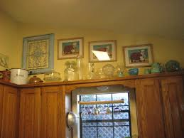 Kitchen Cabinet Top Molding by Above Kitchen Cabinets Ideas Intended For Small Kitchen Design