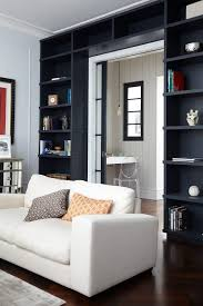 Cream Wood Bookcase Dark Blue Bookcase Living Room Transitional With Industrial