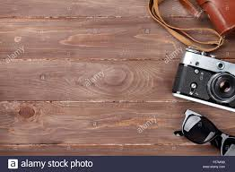 Office Desk Top View Camera And Sunglasses On Office Wooden Desk Table Top View With