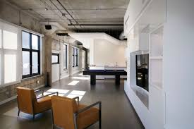 Concrete Ceiling Remodeling Project Merges Two Lofts Into One