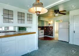 light blue and green kitchen room with carpet and tile floor