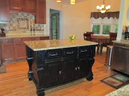 the attractive black kitchen island completed by back chairs bee