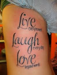 black live lough love tattoo on side rib by vernalee