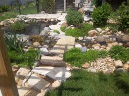 photo of rock path and pond albrecht landscaping