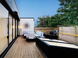 Rooftop Room Design Stunning Black Modular Wall Art On Clear Painted Wall Installed
