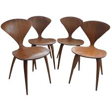set of four vintage plywood and walnut chairs by norman cherner