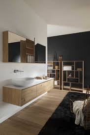 clever use of black feature wall black shaving cabinet instead of