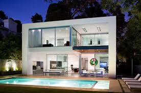 modern house with small swimming pool in the backyard loungechairs