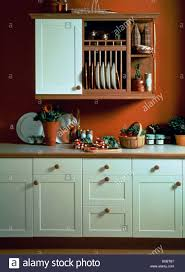 Kitchen Wall Units Plate Rack And Wooden Shelves On Wall Unit In Red Kitchen With
