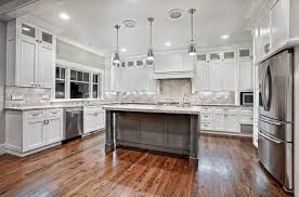 kitchen l shaped white kitchen cabinet with black backsplash