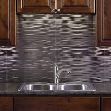menards kitchen backsplash fasade waves 18 x 24 vinyl tile backsplash in brushed nickel