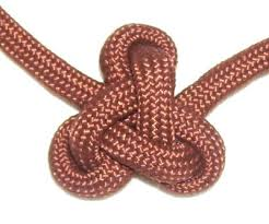 the lambda knot features three loops surrounding a triangular