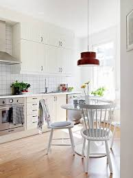 interior white scandinavian kitchen with rustic dinning table