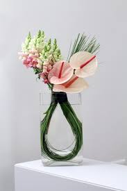 unique flower arrangements brighten up the office with a flowers24hours summer flower
