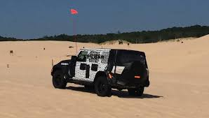 dune jeep caught on camera jeep wrangler jl prototypes drag race in the