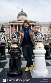 spanish designer jaime hayon poses with his giant ceramic chess